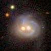 Mosolygós galaxisarc két fekete lyukkal